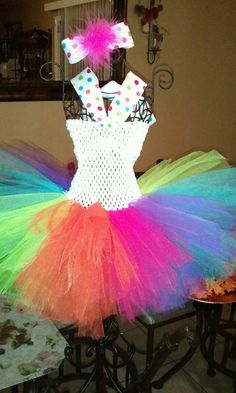 Favorite  Like this item?    Add it to your favorites to revisit it later.  Rainbow Tutu Dress/Birthday OutFit    From luvtutus  Rainbow Tutu Dress/Birthday OutFit  zoom  Rainbow Tutu Dress/Birthday OutFit Rainbow Tutu Dress/Birthday OutFit  This is a Colorful Super Cute Tutu Dress, The tutu is really full and fluff