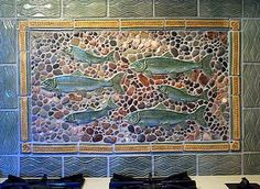 We have these fish tiles and some wave border. Using lighter Agate Beach stones would make a nice bathroom or kitchen accent.