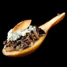 Pear amuse bouche with mushroom duxelles, bleu cheese, and toasted almonds