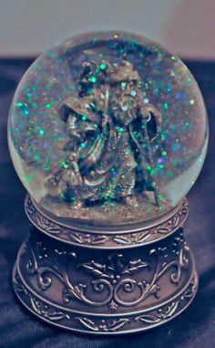 Pewter Santa Snow Globe - So gorgeous! St. Nicholas old-fashioned snow globe in pewter - also a music box! Heavy pewter base and pewter vintage look Santa with all his goodies for Christmas!