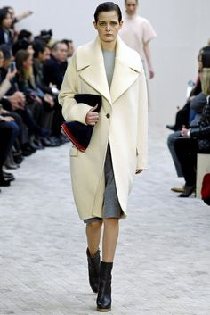 Celine Fall 2013. Similar to the coats from the 1920s because it is close over the left hip with a large decorative button.