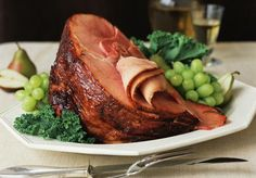 This ham is finished with a brown sugar and maple syrup glaze, spices optional. Ingredients include maple syrup and apple juice, along with a little mustard and brown sugar.