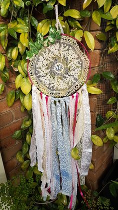 Handmade crochet doily dream catcher with blue butterfly, ivy leaves, blue floral fabric, pink ribbon, lace and pink satin. Hoop width- 12 inches Height- 36 inches Dream catcher will be shipped carefully within business days :) Happy dreaming :) Doily Dream Catchers, Ivy Leaf, Blue Butterfly, Dreamcatchers, Pink Satin, Floral Fabric, Crochet Doilies, Leaves, Green