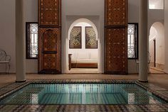 a Moroccan riad, courtyard with a nook and dipping pool