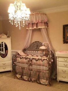 take a gander at this well appointed nursery designed by mom, Amy Wood Blanton and featuring our Chelsea Iron Lifetime in antique silver. we love the valence and bedding!