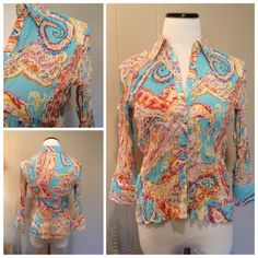 "Paisley top Like new adorable paisley button down. Slightly sheer and very stretchy. 3/4 sleeves. Boutique brand. Tag says size Large but measures like S/M and slightly cropped: 17""UA-stretches further, 21""L. Tops Button Down Shirts"