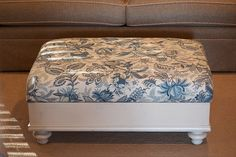 Build a storage ottoman maybe out of an old drawer