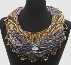 """""""Sleeping Valkyrie"""" embroidered neckpiece by Anya and Slava Black. Soutache, fabric and beads."""
