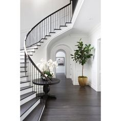 Curved Staircase Wall with Black Round Table ❤ liked on Polyvore featuring backgrounds