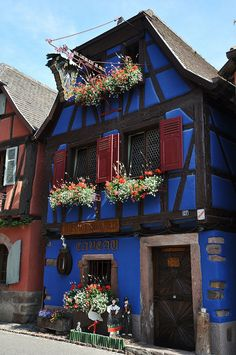Street cottage, Alsace, France  It's not simply the lighting (Alsace is known for), but he soul that's reflected in this area, which comes through in its strength yet softness.