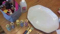 Supplies you will need for painting a ceramic platter.