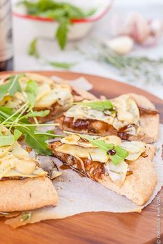 Nutty spelt makes a perfect base for this caramelised onion and vegan potato pizza recipe. Topped with balsamic garlic cashew aioli and a few rocket (arugula) leaves its the perfect thing to serve to friends over a few drinks. | Get the recipe at deliciouseveryday.com