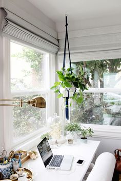 office tour of Emily Henderson // white office, plants, natural light, gold accents // photo by Kimberly Genevieve