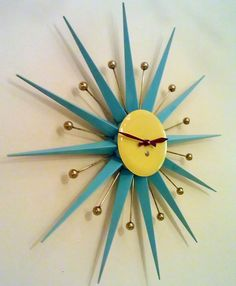 Mid-century starburst clock - I LOVE this clock. It would be perfect in my living room.