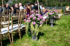 Wedding Isle decor# Wedding urn floral arrangements# purple# green