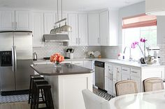 @jennifer_stagg from withHeart is sharing her kitchen remodel reveal today! Our {Alice 3 Light Island Light} tops the kitchen off giving it a modern and sleek look. See the complete reveal and a fabulous video of the kitchen by James Young Productions. #videogod #bloggerstyle