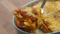 Enchilada Lasagna - homemade enchilada sauce uses chicken broth; swap out dairy cheese & omit chicken or use veggies