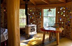 The inside of the little cordwood house... suncatchers built right into the walls...just beautiful!