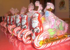 Are you looking for a new idea to entertain the children at your Christmas dinner? These adorable little Santa Candy Sleigh's will serve double duty as table décor' and a gift for the children attending your party.