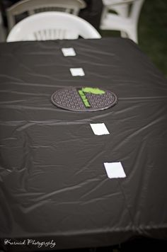 Ninja Turtle Party. Black tablecloths with white duck tape and sewer covers for the middle centerpiece