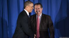 US President Barack Obama is greeted by Business Council chairman Andrew N Liveris, who is also president, chairman and chief executive officer of the Dow Chemical Company. Obama spoke about the possible effects of new budget cuts to the council before taking questions in a closed session.