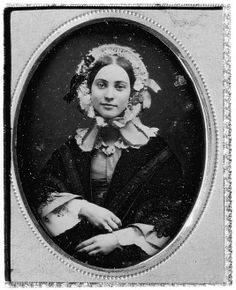 Woman in Flowered Bonnet          Photographer Unknown          Date: 1850s       Medium: Daguerreotype    Dimensions: 5.2 x 3.9 cm. (2 1/16 x 1 9/16 in.)    Classification: Photographs    Credit Line: Gift of Juliet Thompson, 1946 Accession Number: 46.63.2    Metropolitan Museum of Art
