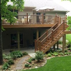 This wooded backyard in Ankeny deserved nothing less than the beauty and durability of TimberTech's Earthwood Tropical Teak composite decking. Moutain Cedar Radiance Rail. Designed, configured and built by Des Moines premier deck builder, Archadeck of Central Iowa.
