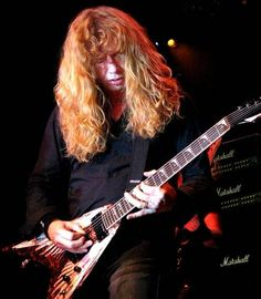 """Dave Mustaine: in 2002 fell asleep with his arm in an awkward position, that cut off the circulation to the radial ulnar nerve in his left bicep """"Saturday Night Palsy"""". Unable to feel or properly move his hand. After four months of extensive Chiropractic care, PT, acupuncture, and weight training he was able to fully recover from his nerve injury, as well as older  tendon damage in his finger. After being pronounced 100% healed by his doctor, Dave took on the task of relearning to play…"""