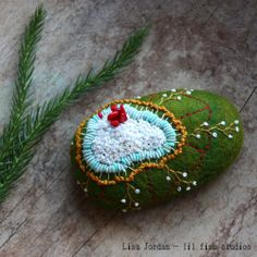 stitched stone by Lisa Jordan of lil fish studios - real stone covered in wool and embroidered