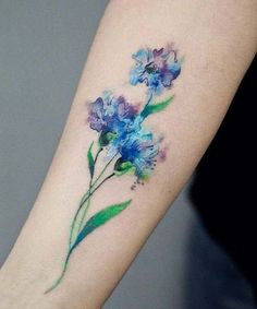 Fabulous Watercolor Flower Tattoo Design on Forearm with Attracting Colors. Watercolor Tattoos are Most Demanding Tattoos fro Every Age of Men and Women Which Can Be Temporarily Placed and are Easy to Remove.