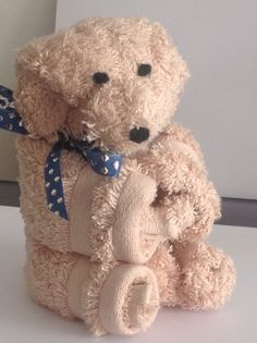 Terry Bear..... made from two cotton wash cloths.  No wash cloths are harmed in the making, just undo the elastic and ribbon to turn them back to the original shape.