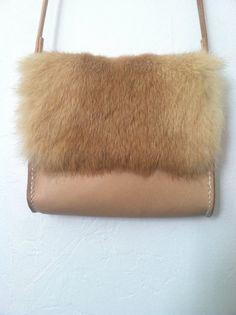 I loooove it!!!!! Rabbit fur and leather petite cross body by MidniteLeatherGoods, $60.00