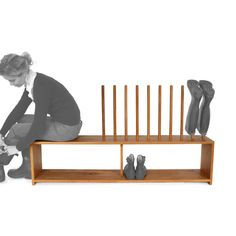 Oak welly and shoe rack with integral seat for 5 pairs of wellington boots and shoes. Wooden stand in solid Oak with welly rack above, shoe shelf below