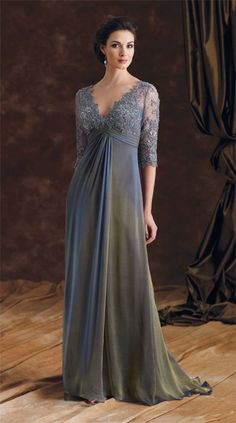 Etoile Et Ciel Gown---Translates to stars & sky, an iridescent blue/gold silk chiffon is graced with shimmered hand-beaded cobweb lace, pleated empire waist with sweeping train and front drape. Victorian Trading Company