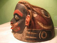 Tlingit warrior helmet carved in the form of a human; wood, human hair, abalone shell, animal fur, polychrome; has bold formline design on its dome. St. Petersburg Russia. via Tommy Joseph FB