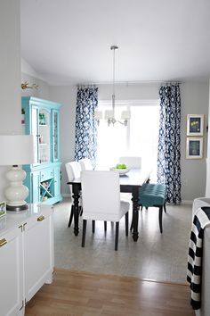 Dining Room! Pop of color in the hutch, white chairs, dark table.