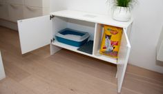 Catinet - Basic cabinet allows for kitty litter to be hidden from view but still accessible. Once doors are shut, Cats access their litterbox through the door in the side behind the extra litter compartment.