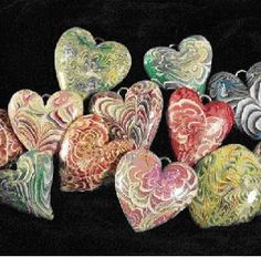 кулоны в виде сердечек на день Валентина