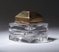 Baccarat perfume bottle for Myon, circa 1928, in clear crystal with enameled metal stopper cover.