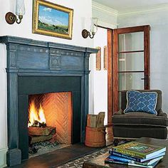 lovely fireplace painted with blue milk paint