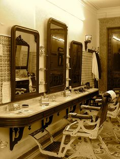 wrought iron barber chairs in The Barber's Shop Matos in Braga. Barber Shop Interior, Barber Shop Decor, Victory Rolls, Interior Design Magazine, Vintage Barber, Old School Barber Shop, Barbershop Design, Barbershop Ideas, Master Barber