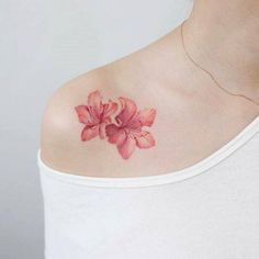 Stunning pink blossoms by Tattooist Charming And Irresistible Rib Tattoos Sexy and Charming Shoulder Tattoo Designs for Charming Book Tattoo Designs Ideas For Bookworms Trendy Tattoos, Small Tattoos, Small Lily Tattoo, Popular Tattoos, Tattoos For Guys, Tatouage Plumeria, Wildflowers Tattoo, Tattoo Flowers, Butterfly Tattoos