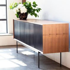 The Egon Sideboard combines pure lightness of form with an elegant modern aesthetic. A smart wrap-around steel frame gracefully envelopes 4 soft close walnut veneer doors presenting a unique minimalist appeal. Bookcase Storage, Bench With Storage, Table Storage, Bedroom Furniture For Sale, White Furniture, Dining Room Furniture, Mid Century Modern Sideboard, Mid Century Dining, Dinette Sets