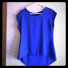 Blue Cap Sleeve Top This blue top is great for work or casual occasions and is in perfect condition! The clear straps have been cut out for comfort purposes. 100% polyester Love + Haight Tops Tees - Short Sleeve