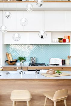 9 Inspirational Kitchens With Geometric Tiles // Shiny light blue rectangular tiles laid out in a herringbone pattern create the backsplash of this Vancouver apartment. Kitchen Interior, New Kitchen, Kitchen Dining, Kitchen Decor, Kitchen White, Kitchen Modern, Kitchen Island, Kitchen Ideas, Kitchen Lamps