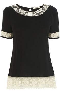 This pretty t-shirt style top features a contrasting daisy mesh trim on the collar, sleeves and hem. The piece features a crew neckline and wide short sleeves. The top is finished with a keyhole cutout at the nape of the neck.