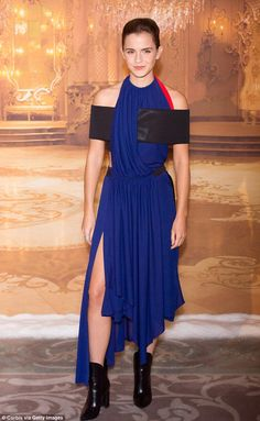 Feeling blue: Emma Watson ensured she turned heads as she attended the Beauty and the Beast photocall in Paris on Monday
