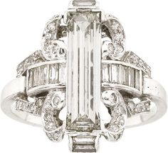 Art Deco Diamond, Platinum Ring The ring features a baguette-cut diamond measuring 13.65 x 3.85 x 2.70 mm and weighing approximately 1.20 carats, enhanced by baguette and single-cut diamonds, set in platinum.