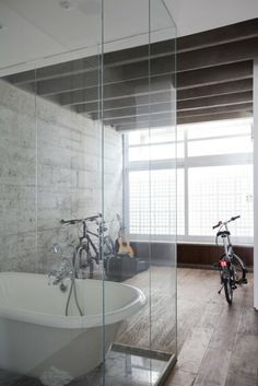 Tub in glass cube