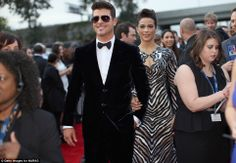 Celebrity couple Robin Thicke and Paula Patton at the Grammys. via dailymail.co.uk